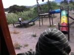 Waving to kids on Salinas playground as we rode by
